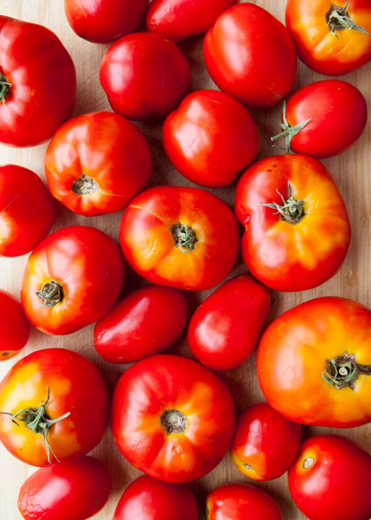 large red tomatoes on table