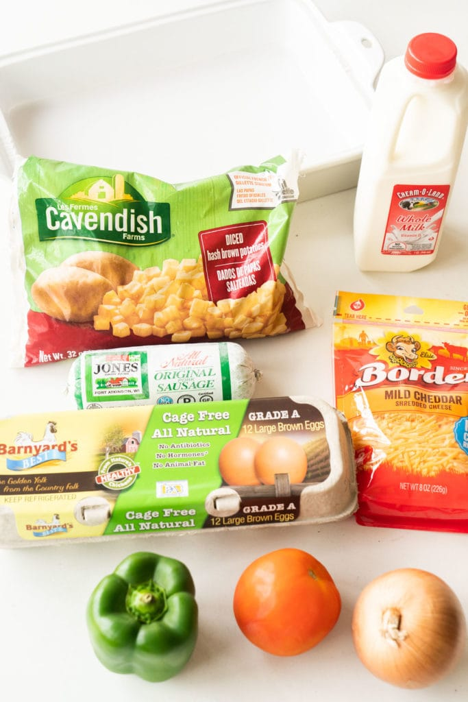ingredients to make hashbrown casserole on white background