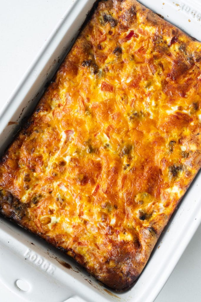 baked cheesy casserole in white baking dish