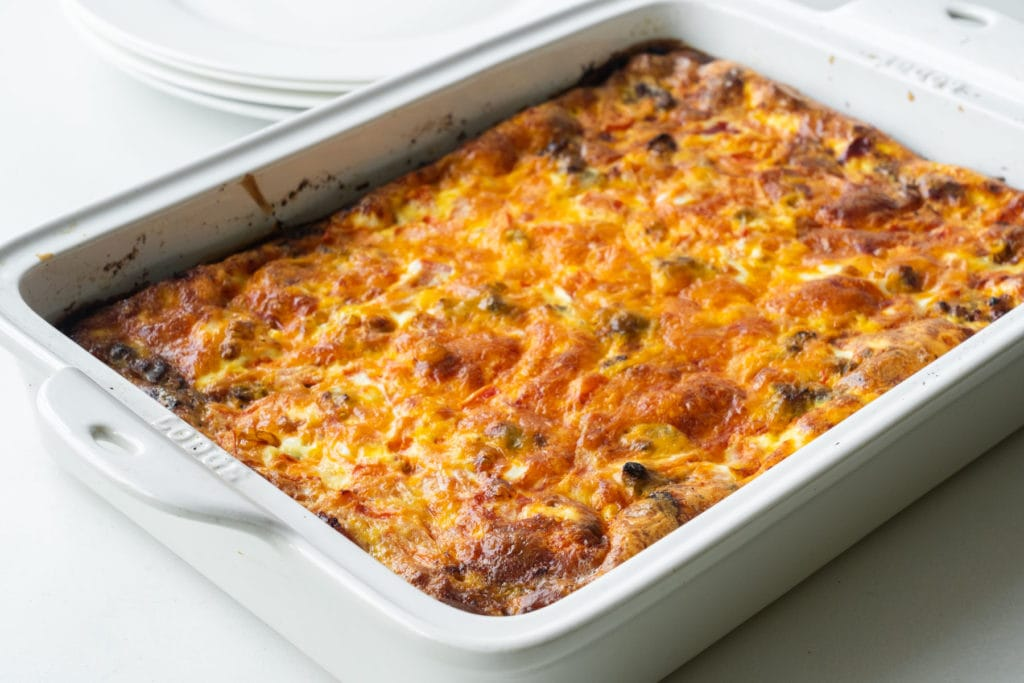 baked egg casserole in white baking dish out of the oven