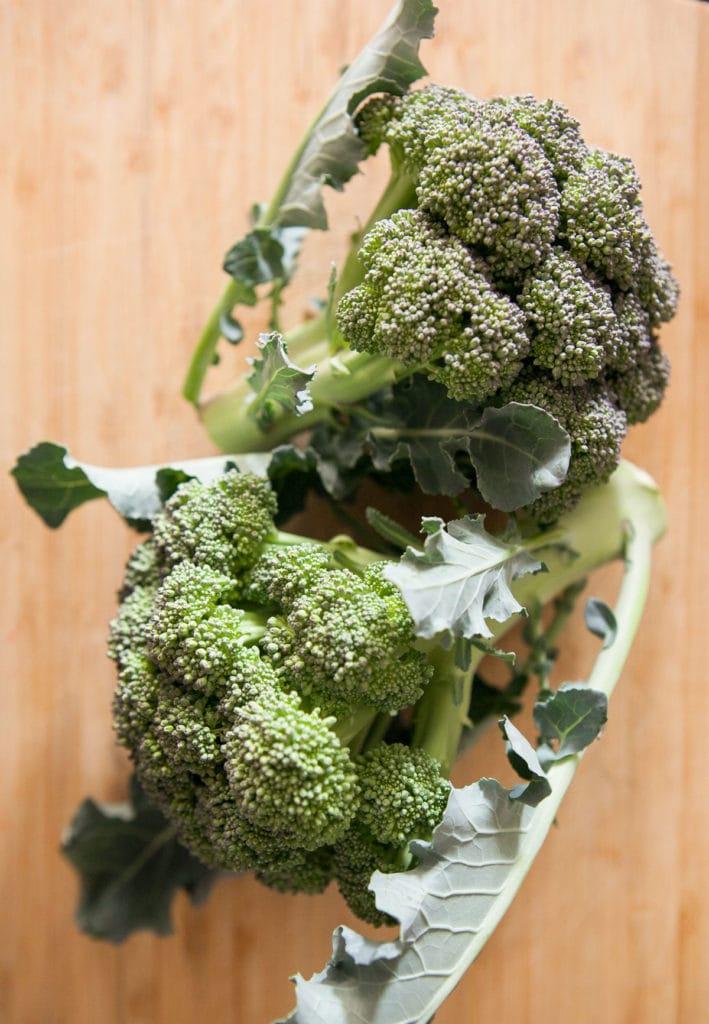 broccoli heads on cutting board