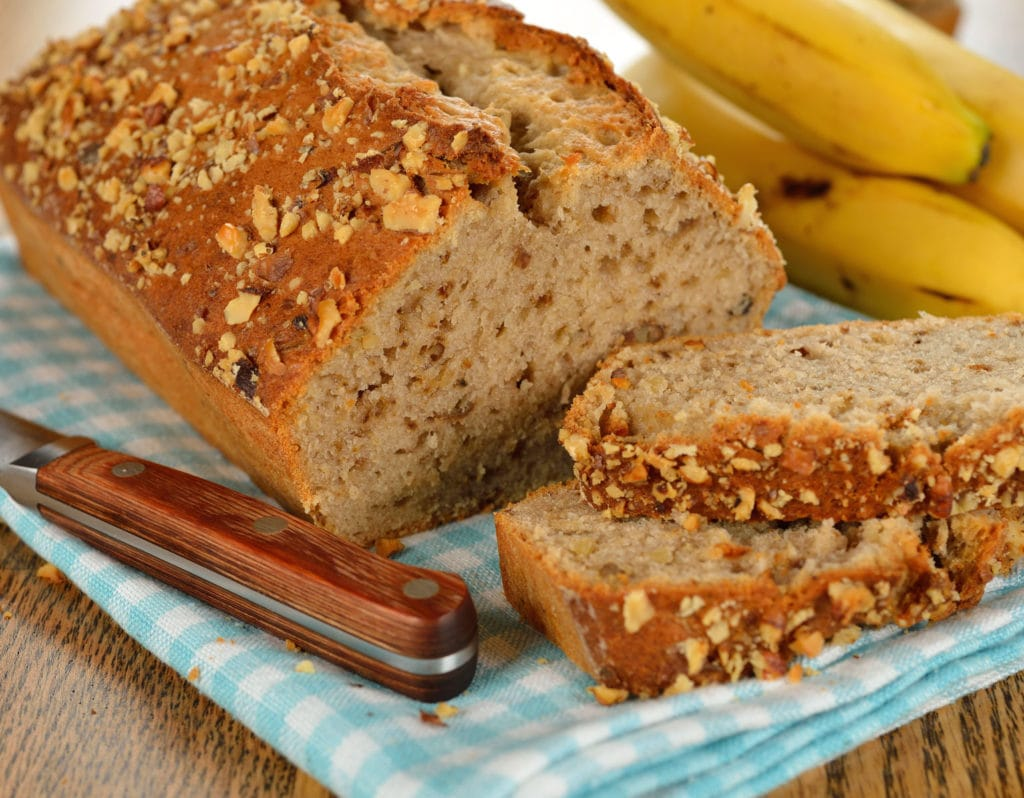 NO BUTTER Banana Bread recipe is easy to make and makes a fluffy, moist bread!   It's so good you won't miss the butter at all (also easy to make vegan).