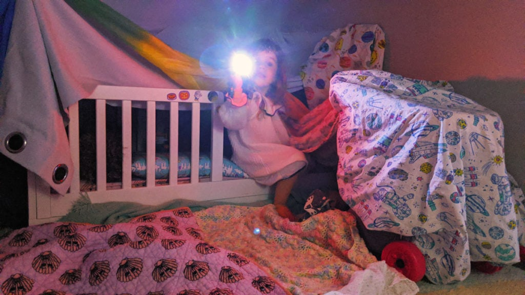 Blanket fort in toddlers room.