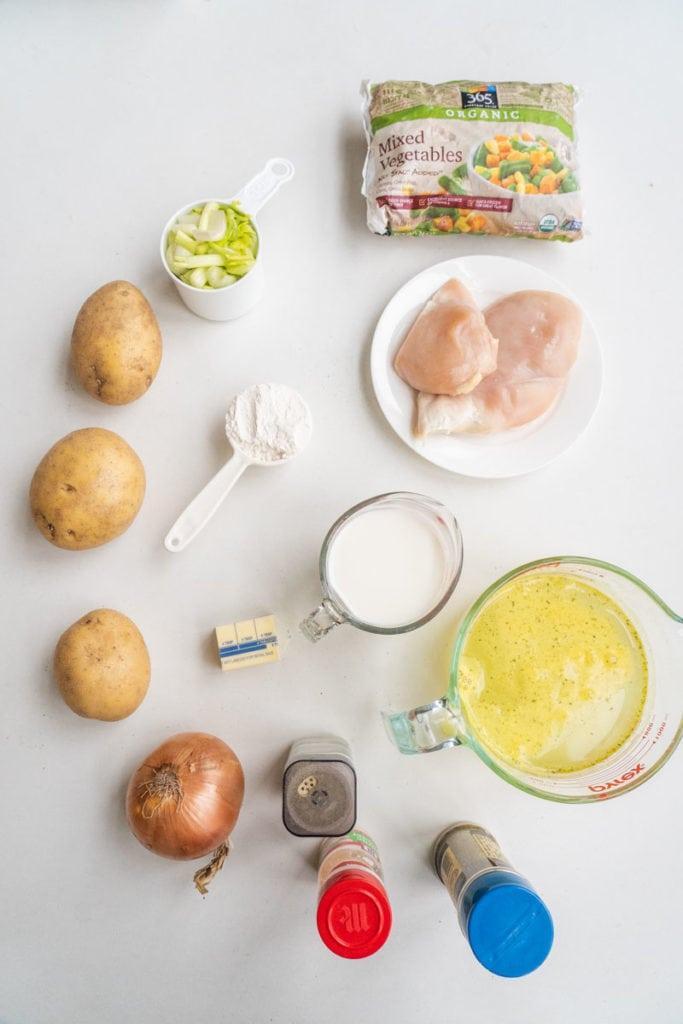 Ingredients on white background to make Crockpot Chicken Pot Pie