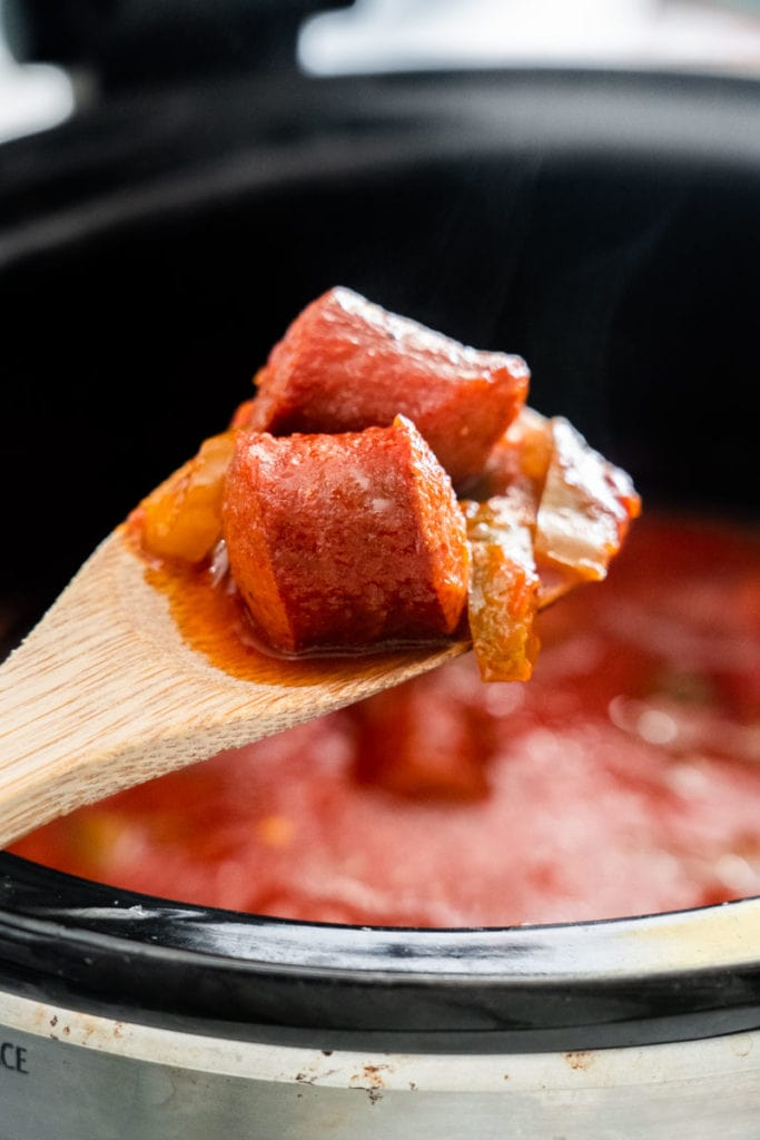 Easy Crock Pot Kielbasa slow cooked with savory tomato sauce, peppers and onions.  Serve over rice, noodles or put on a roll for a sausage sub!