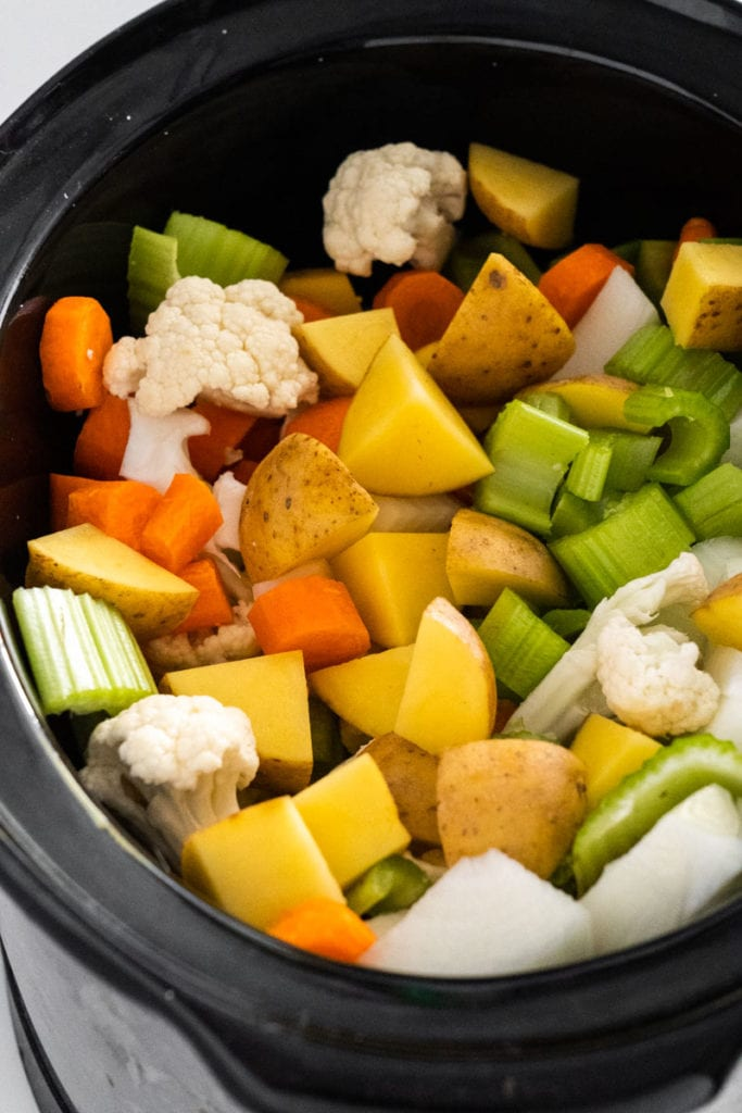 chopped up vegetables in crockpot