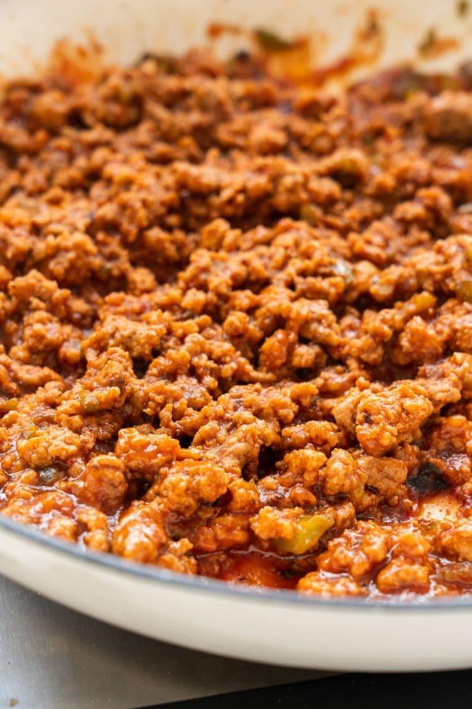 sloppy joe sauce on top of ground meat