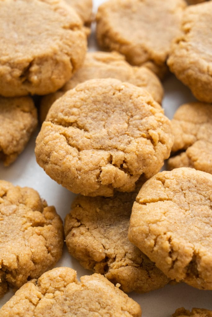 Easy peanut butter cookies recipe made with no flour.  These simple chewy cookies are made with only 4 ingredients!   These are one of my family's favorite cookies and I love how quick they are to make!
