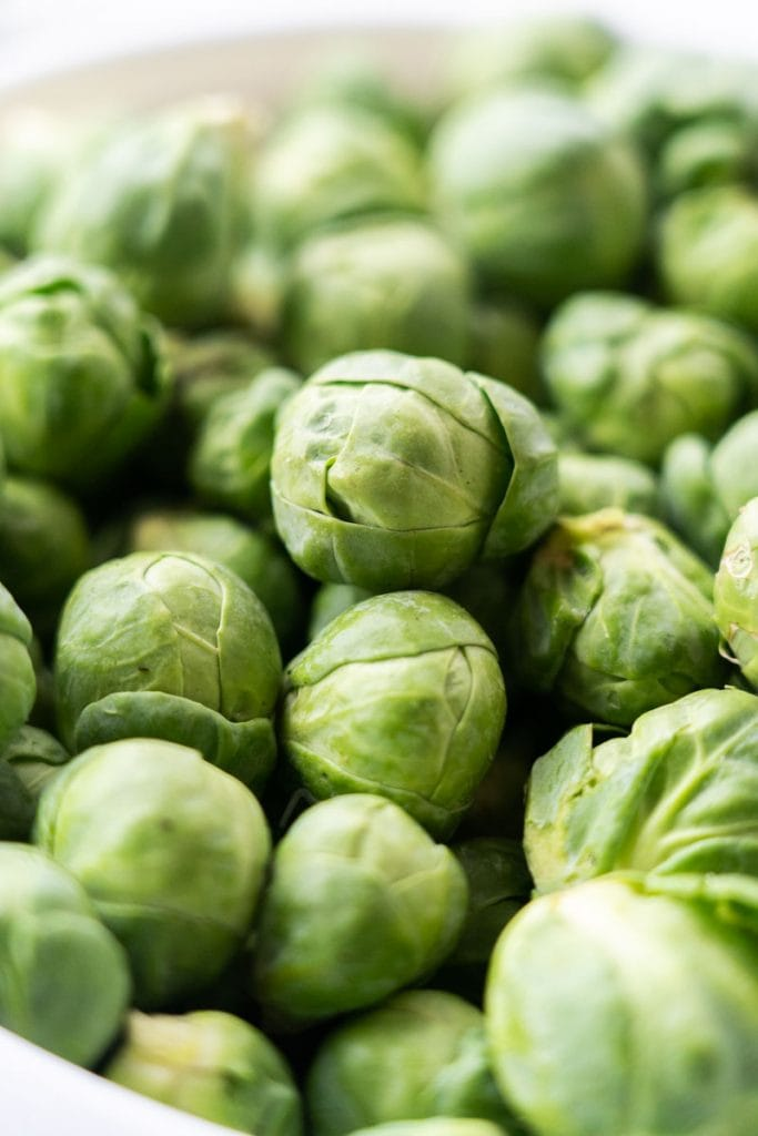 whole fresh brussels sprouts in bowl