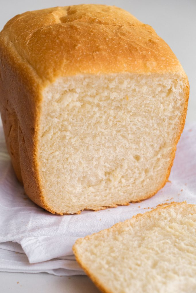 loaf of homemade white bread made in the bread machine