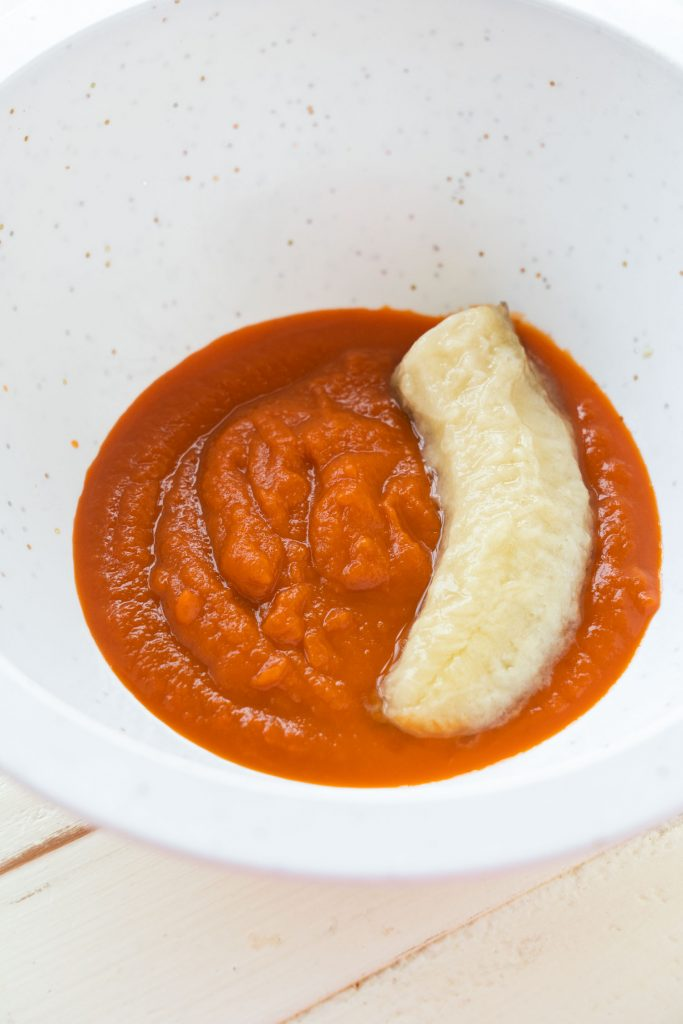 pureed carrots and banana in white bowl