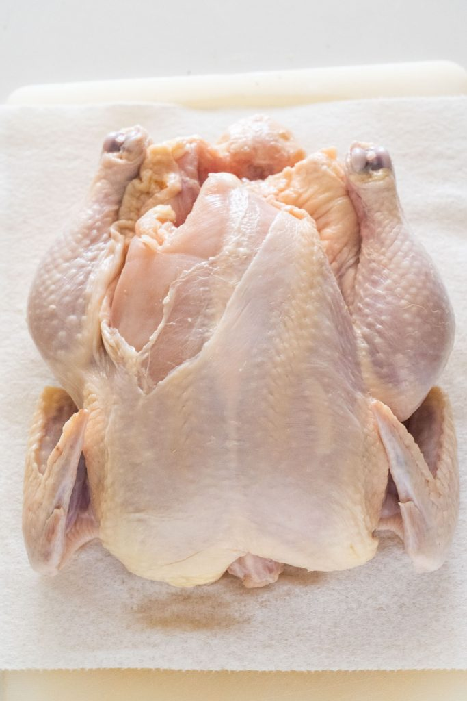 whole chicken sitting on paper towels