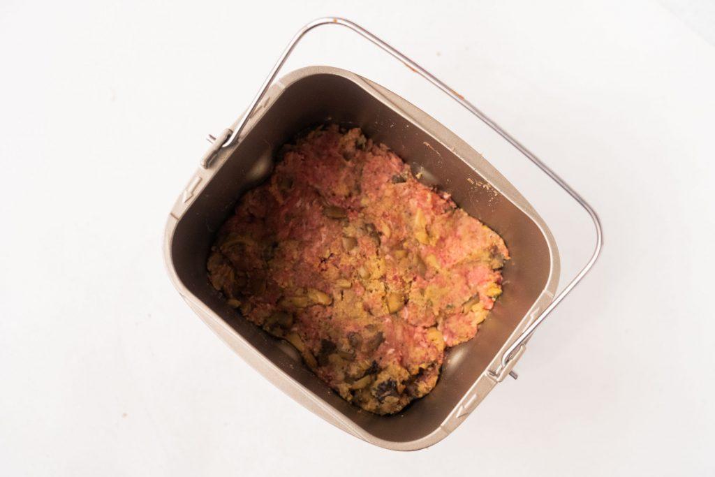 uncooked meatloaf in bread machine baking pan