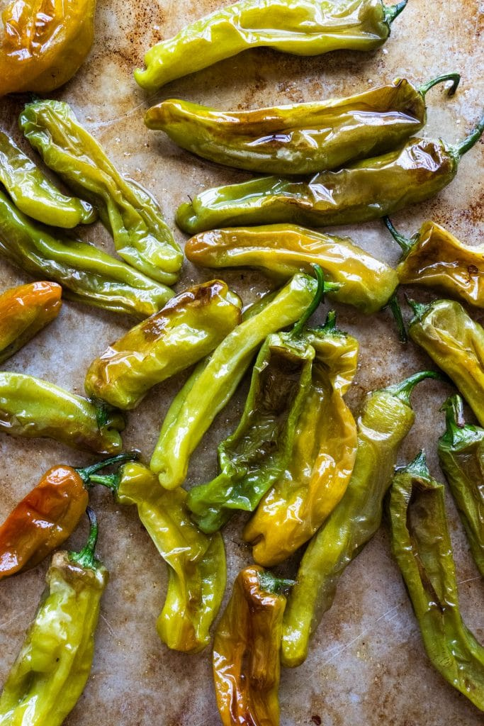 shishito peppers roasted in olive oil and salt on baking sheet