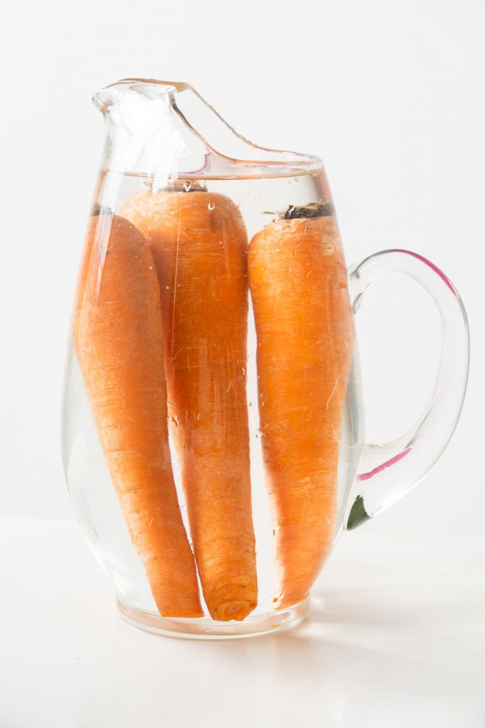 storing carrots in pitcher covered with water