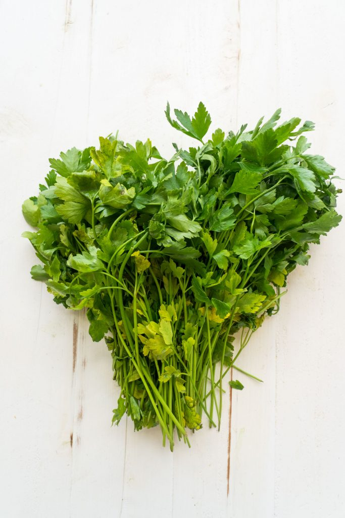 fresh parsley from the garden on white table