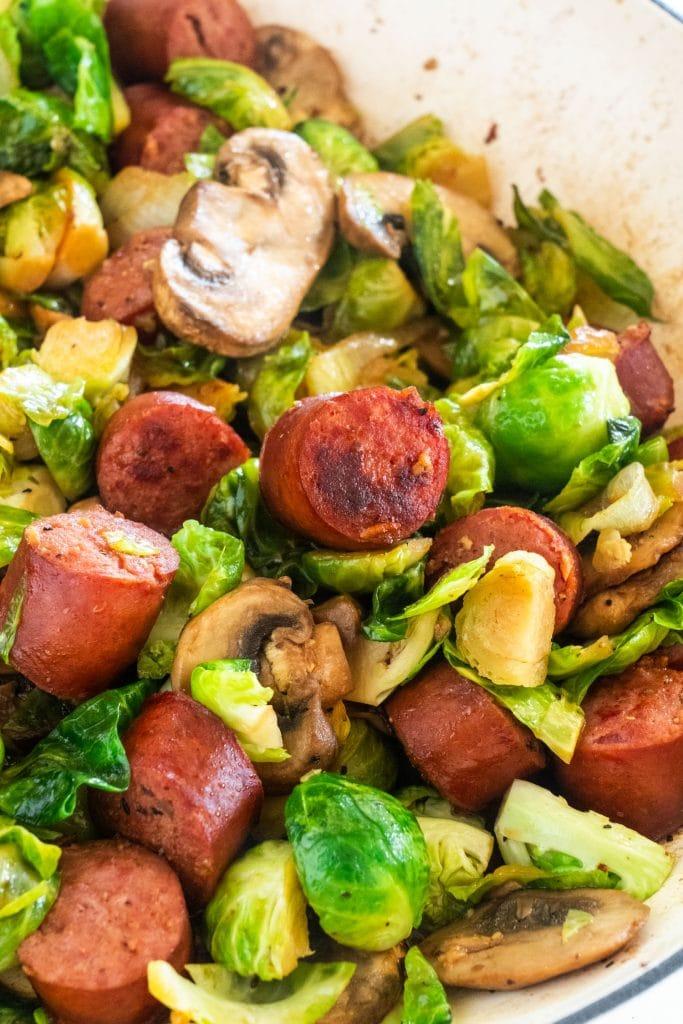 browned kielbasa in skillet with vegetables