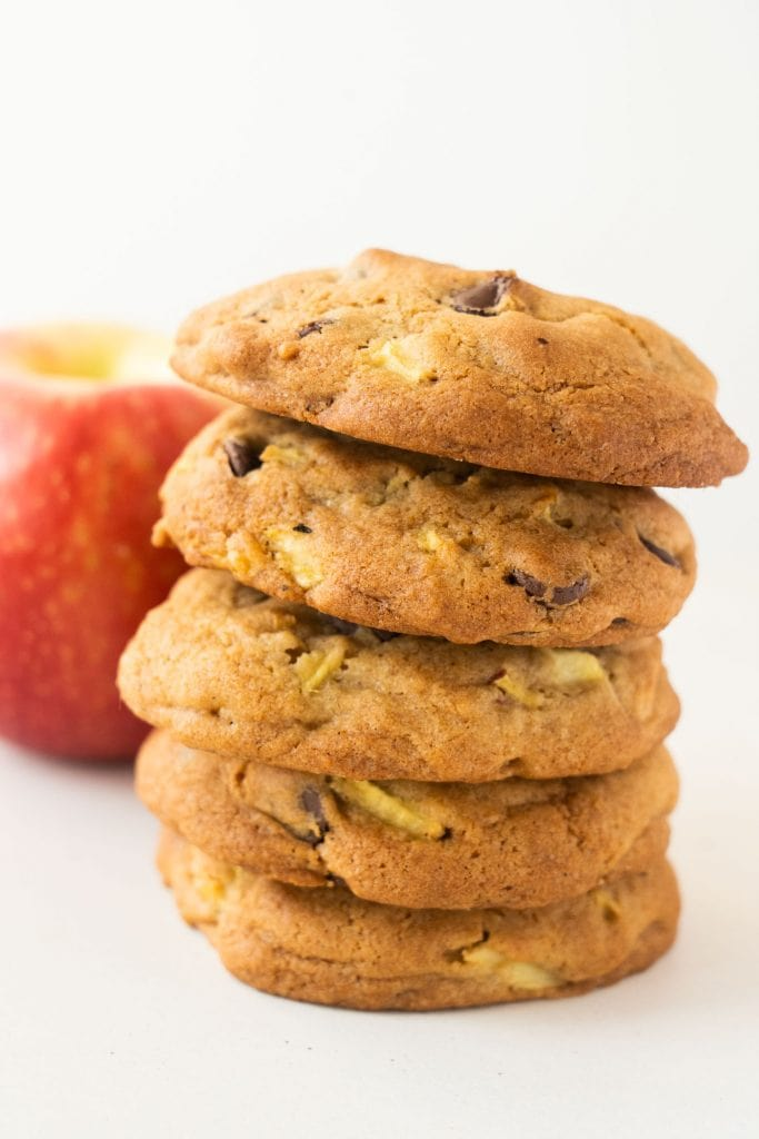 stack of apple pie cookies in front of red apple