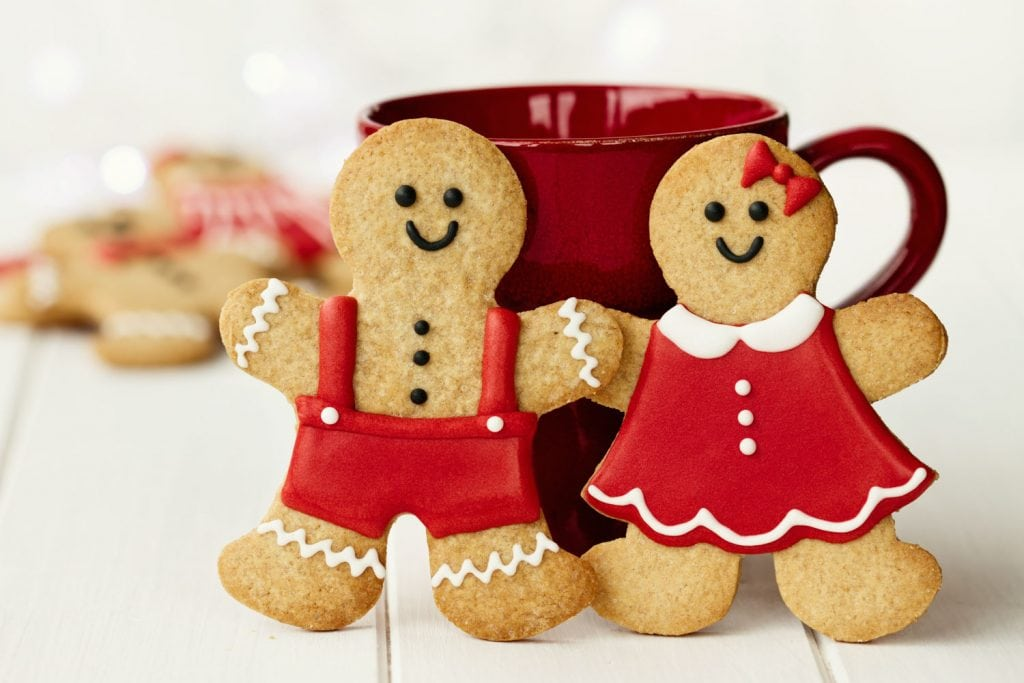 gingerbread men and women cookies in front of red mug