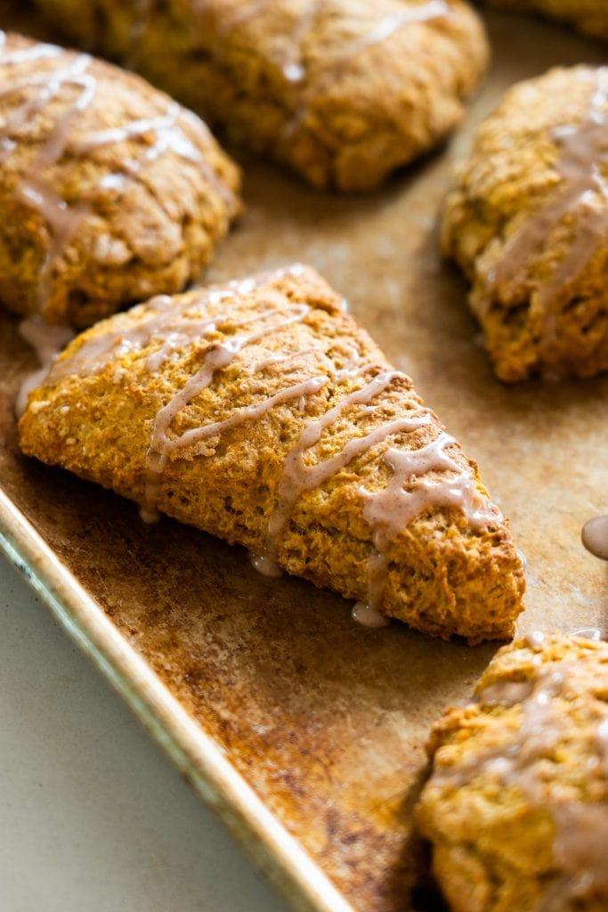 pumpkin scone with vanilla cinnaon glaze running off