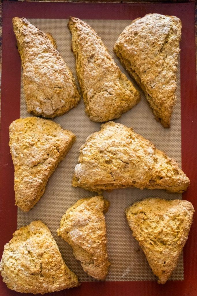 8 baked pumpkin scones on siilcone baking mat