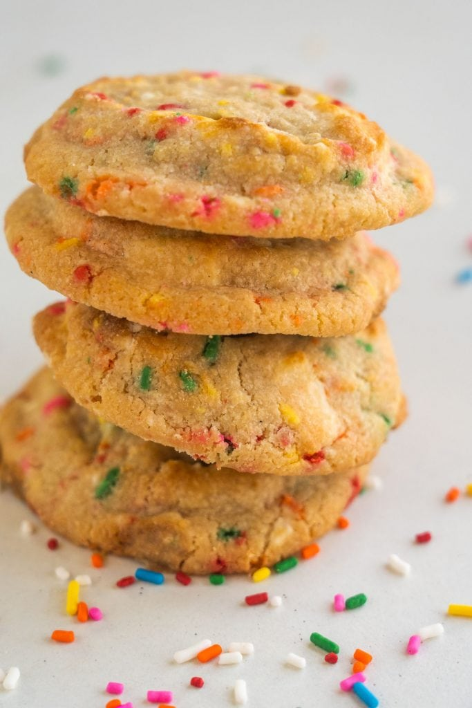 stack of confetti cookies on white table
