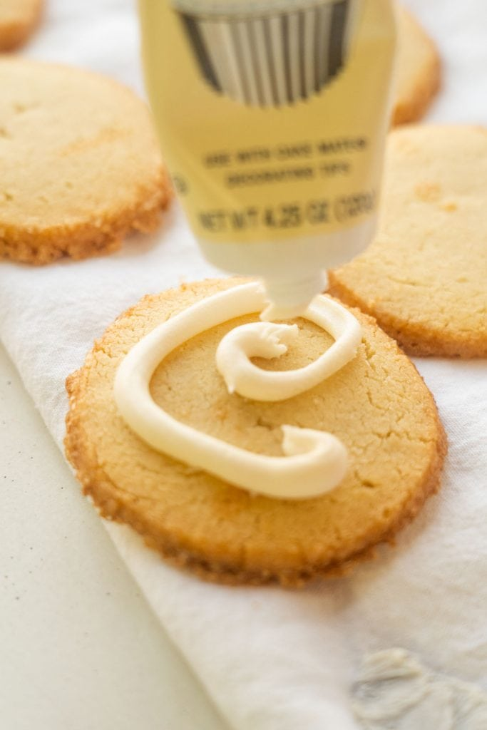swirl of white frosting on cookie