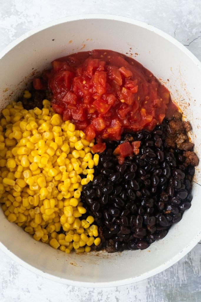 diced tomatoes, black beans and corn in white pot