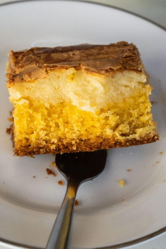 a fork going into a slice of cake mix butter cake