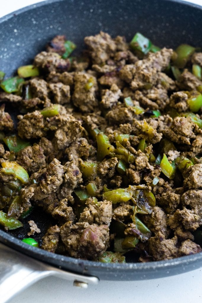 ground beef and green peppers in frying pan
