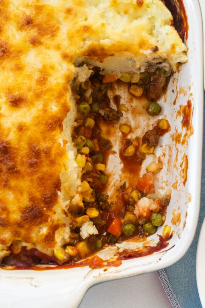 shepherd's pie in baking dish with bottom portion already cut out