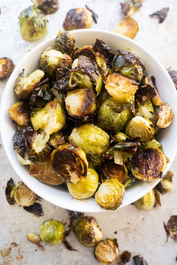 white bowl filled with roasted brussels sprouts