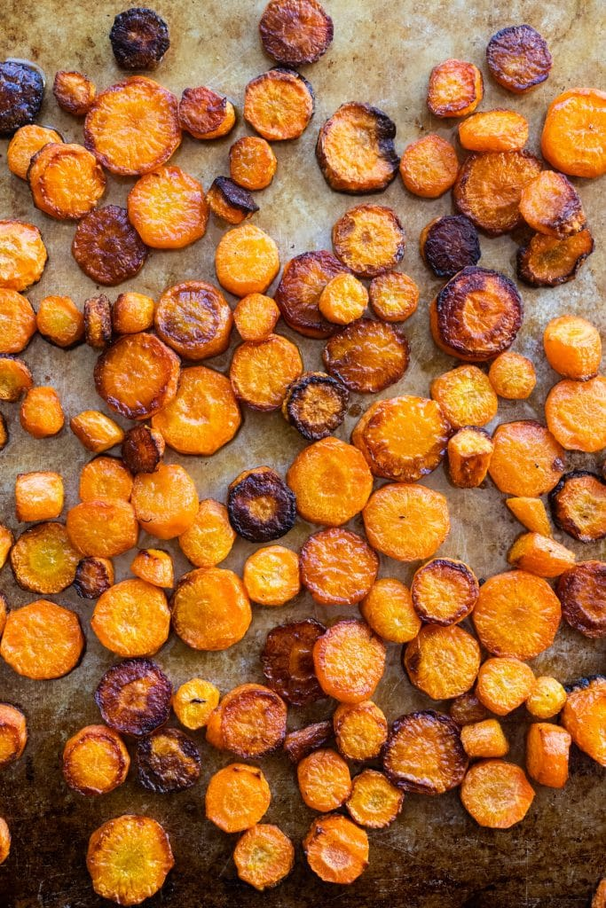 roasted carrots ready to be served on baking sheet