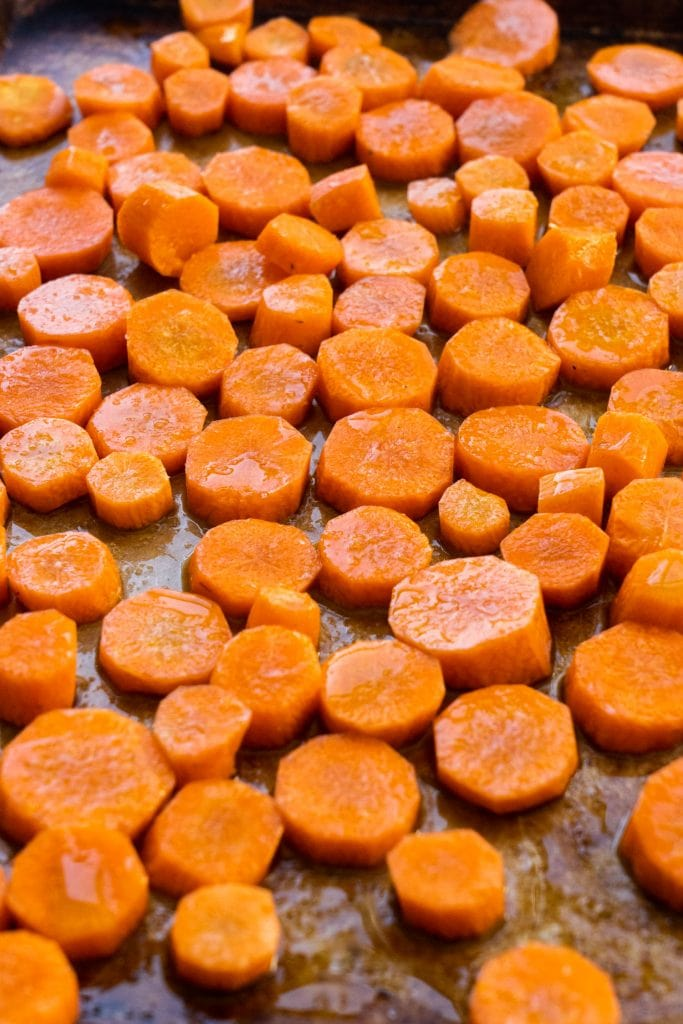 carrots with olive oil on them on baking sheet
