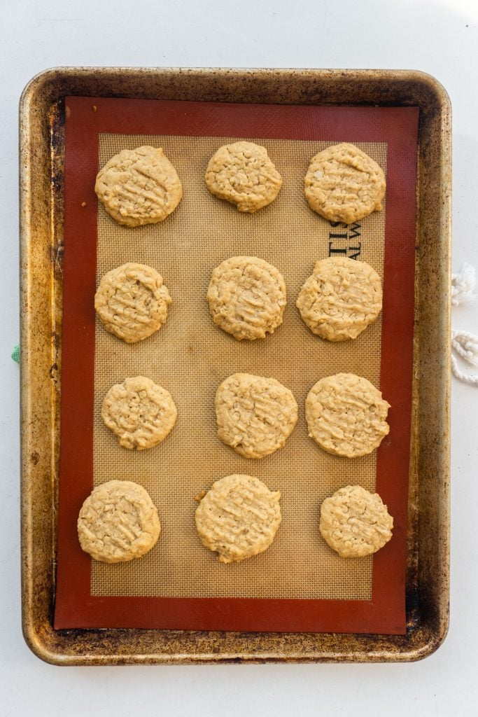 peanut butter cookies baked on cookie sheet