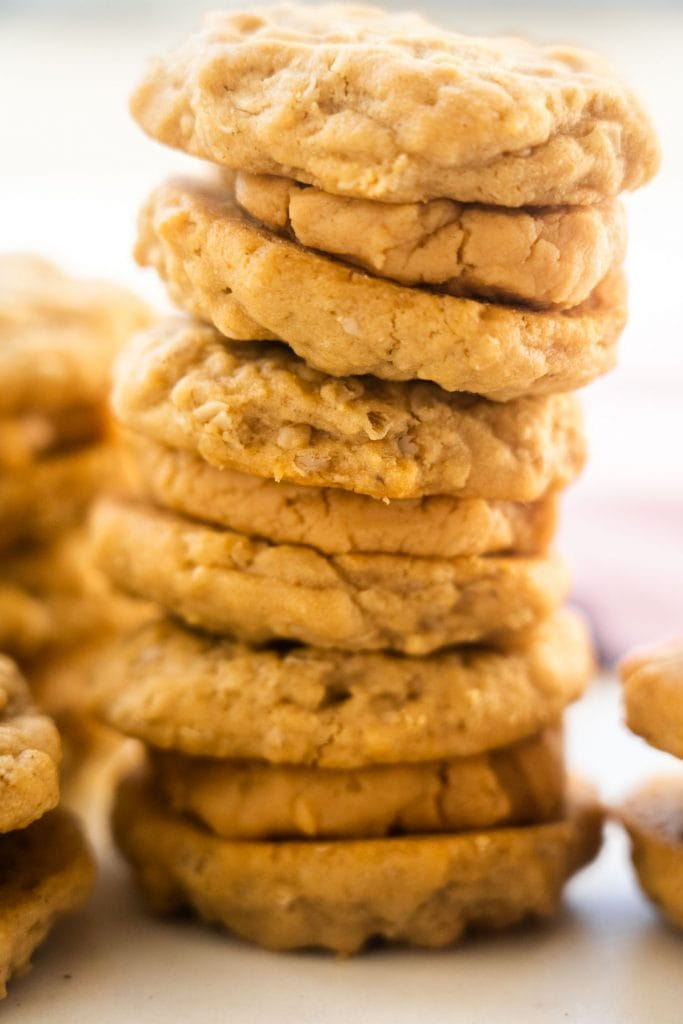 peanut butter sandwich cookies stacked up on white table
