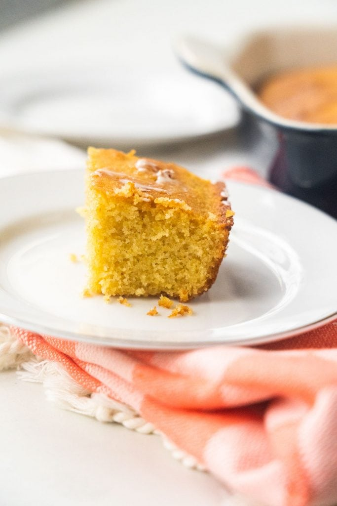 piece of corn bread on white plate