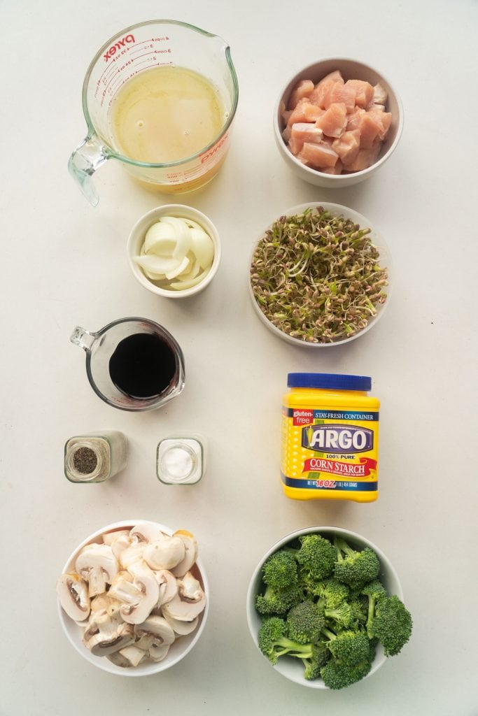 ingredients on table, chicken broth, chicken breast, onion, bean sprouts, soy sauce, salt, pepper, corn starch, broccoli and mushrooms