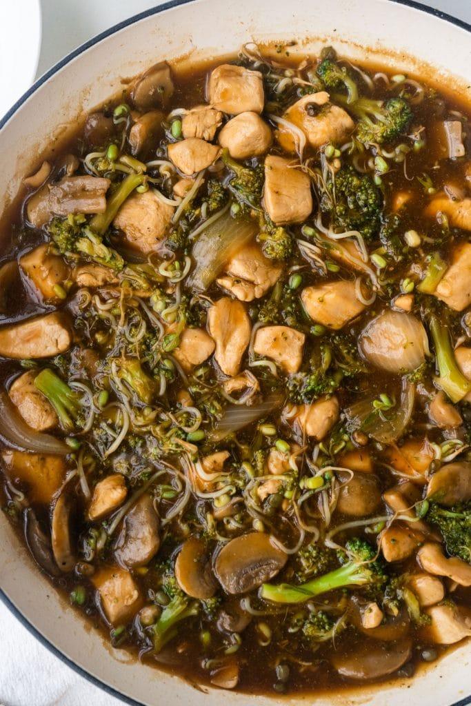 chicken chow mein in white skillet