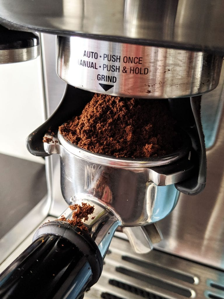 ground up coffee coming out of machine