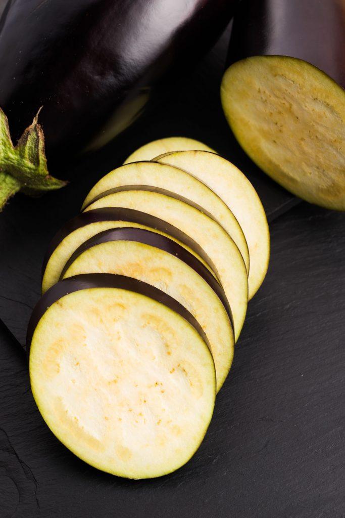 sliced eggplant on cutting board