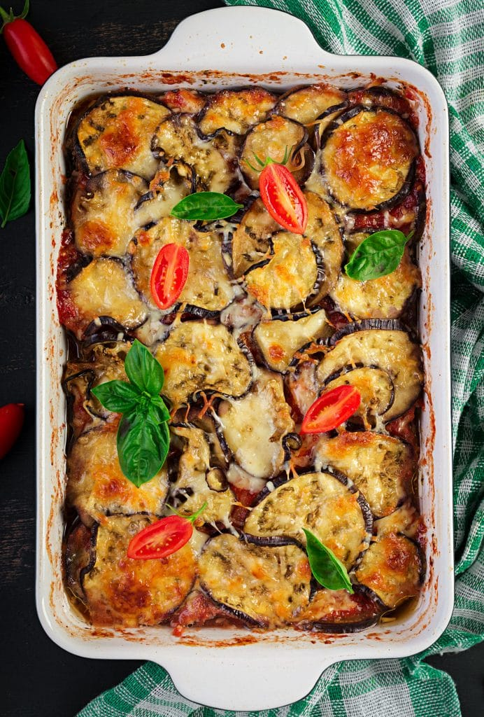 cheesy eggplant casserole in white baking dish