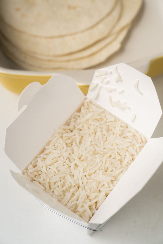 carton of leftover rice on table