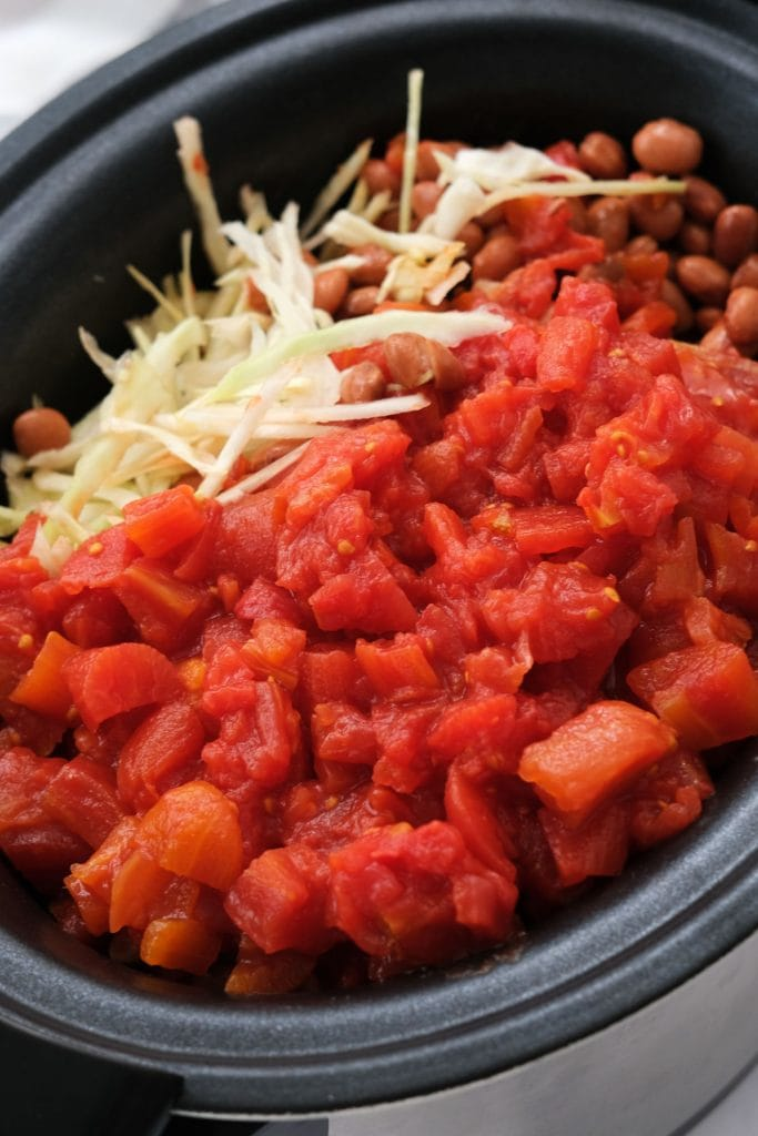 cabbage, beans and tomatoes in slow cooker.
