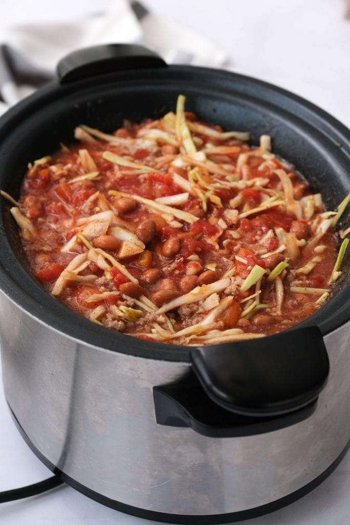 cabbage soup in slow cooker on table, ready to be served.