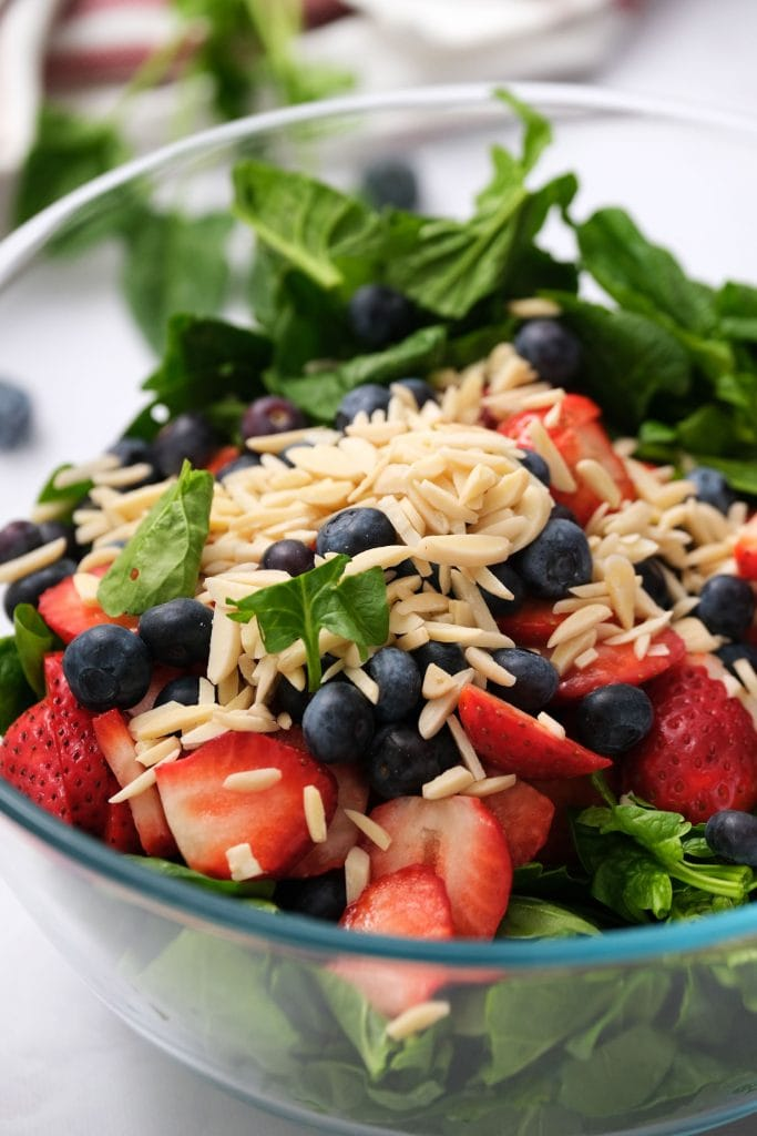 spinach, strawberries, blueberries and almonds in bowl