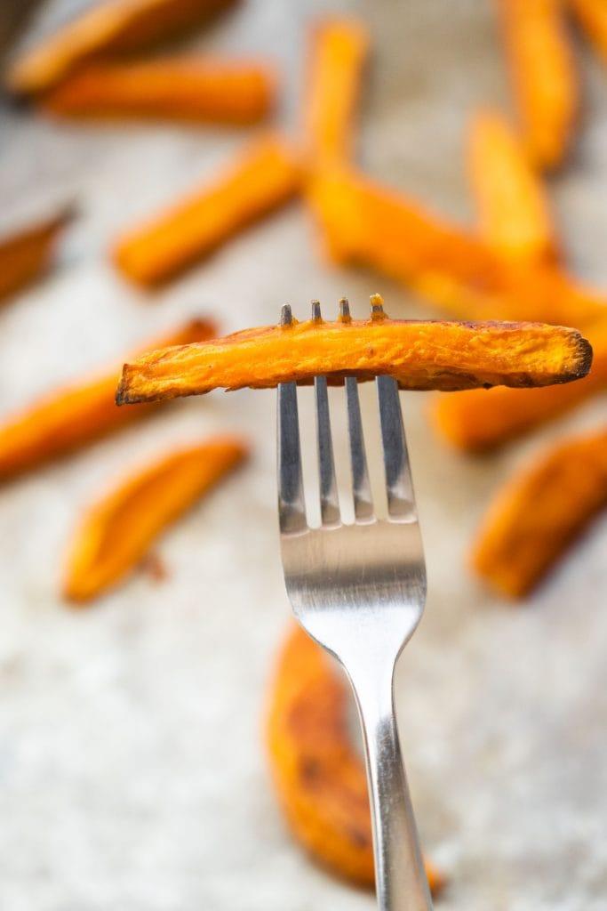 fork going through sweet potato.