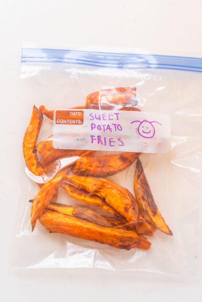 sweet potato fries in freezer bag on white table.