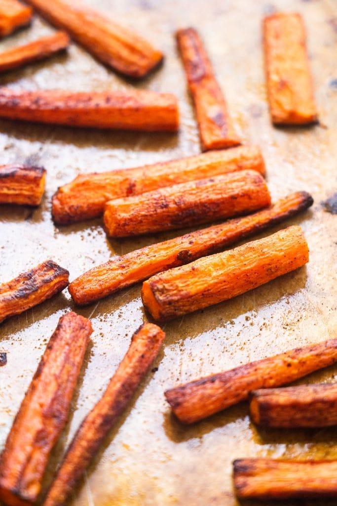 cinnamon on carrots on baking sheet.