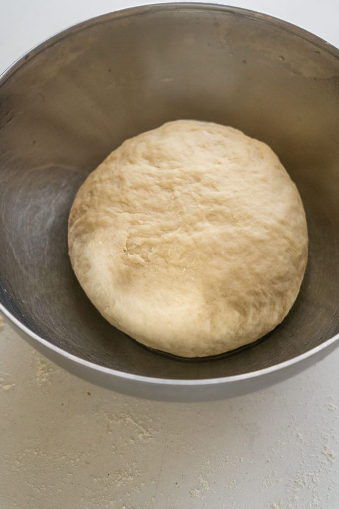unrised dough in greased bowl.
